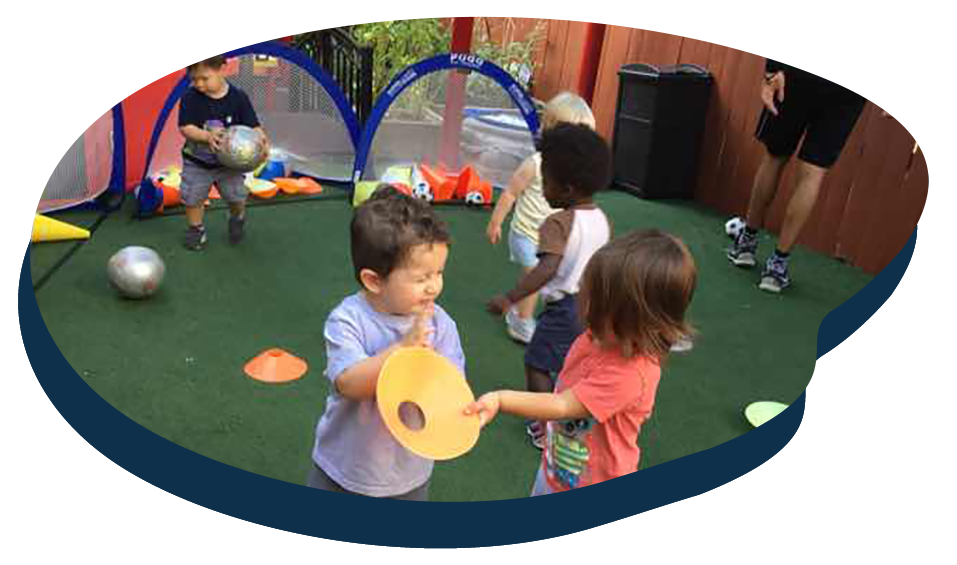 Group of diverse preschool kids enjoy playing at the playground at a Preschool & Daycare Serving Washington, DC