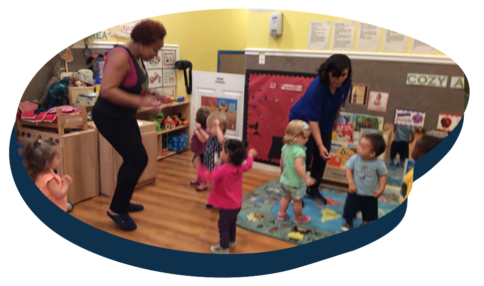 Teachers showing little toddlers some dance moves , early developmental activity at a Preschool & Daycare Serving Washington, DC