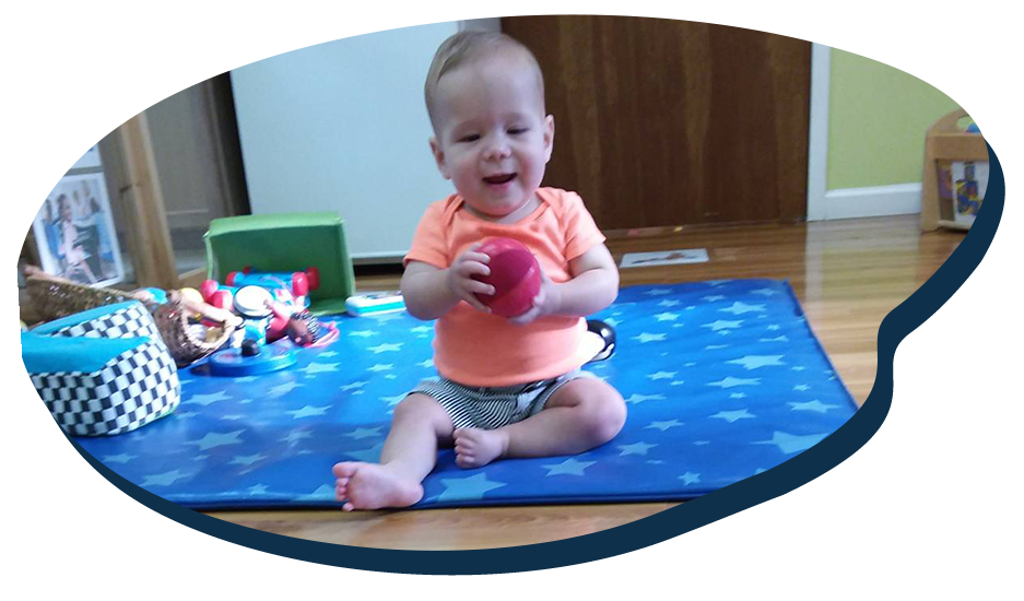 Little baby playing with soft cotton toy ball, enjoy playing with safe toys, at a Preschool & Daycare Serving Washington, DC