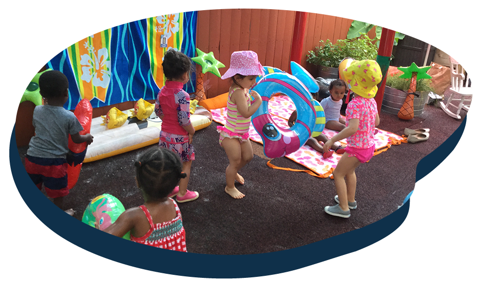 Group of diverse children playing with pool float, preparing for a swim at a Preschool & Daycare Serving Washington, DC