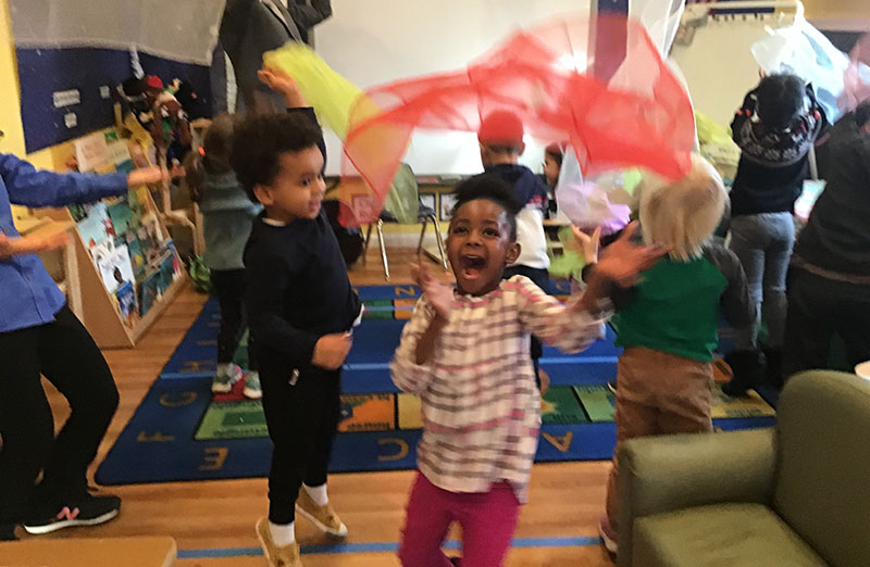Happy little kids enjoy playing in their classroom activity at a Preschool & Daycare Serving Washington, DC