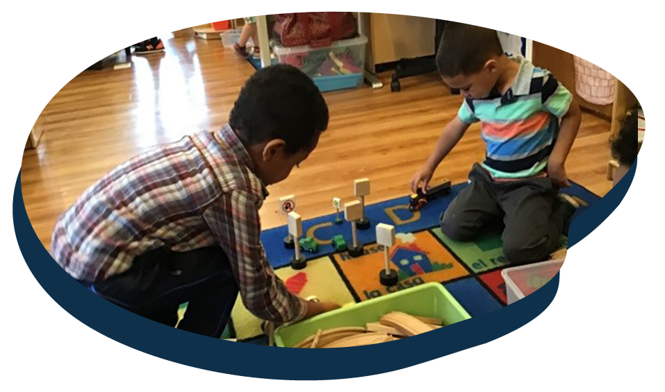 African american kid boys playing with educational building blocks at a Preschool & Daycare Serving Washington, DC