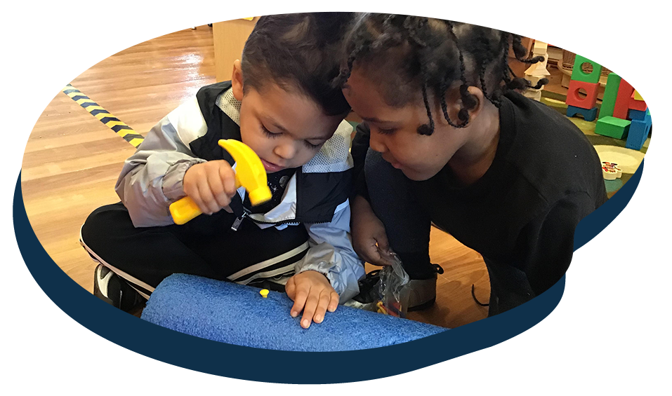 Two young little kids playing with plastic carpentry tools, early developmental at a Preschool & Daycare Serving Washington, DC