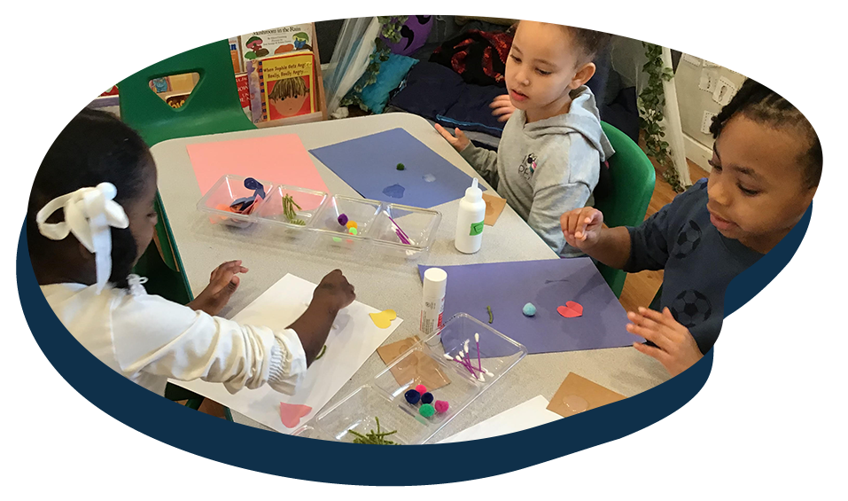 Group of diverse young kids doing art projects inside class, Art activity at a Preschool & Daycare Serving Washington, DC