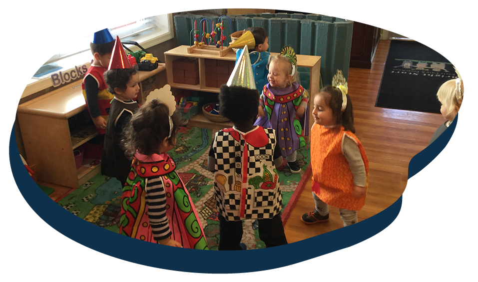 Group of toddlers in costume enjoying and playing inside classroom at a Preschool & Daycare Serving Washington, DC
