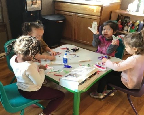 Group of young little preschool girls doing art activity at a Preschool & Daycare Serving Washington, DC