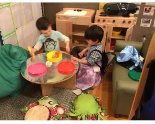 kid boys playing with colorful plastic kitchen utensils at a Preschool & Daycare Serving Washington, DC