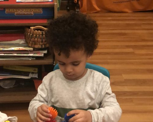 African american preschool boy playing with educational building blocks at a Preschool & Daycare Serving Washington, DC